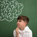 Child thinking with a thought bubble of question marks
